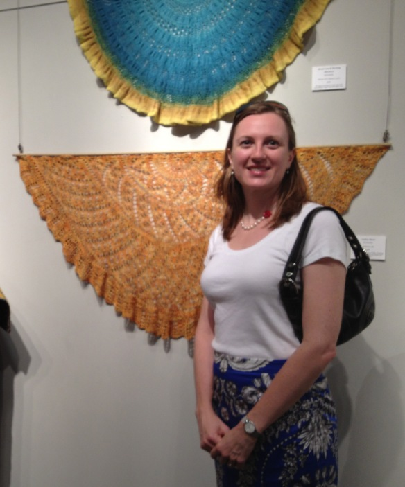 Jill Zarestky, in front of some of her at the current Arts Council of the Brazos Valley exhibition.
