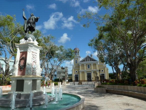 Christopher Columbus statue and fountain in the town plaza in Mayaguez, Puerta Rico.