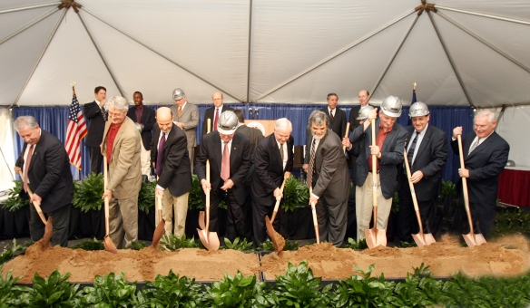 Groundbreaking for the George P. and Cynthia Woods Mitchell Institute for Fundamental Physics and Astronomy and the George P. Mitchell '40 Physics Building. Mr. Mitchell (hard hat), Dr. Gates and Joe Newton are pictured at center, along with several other Texas A&M professors and key administrators.