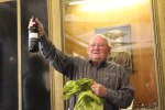 Age is just a number to Chemistry Professor Emeritus John P. Fackler Jr., seen here showing off a bottle of wine he received at his 80th birthday celebration in July 2014.