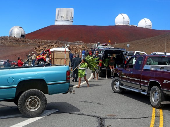 Protesters blocked the road to put a stop to a groundbreaking ceremony for the Thirty Meter Telescope at Mauna Kea, Hawaii, in October. (Credit Hawaii Tribune-Herald, via Associated Press)
