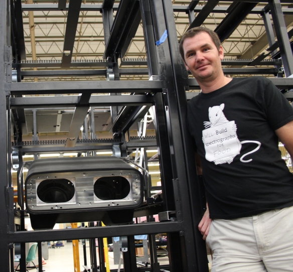 Former Physics and Astronomy research associate and Munnerlyn Lab member Jean-Philippe Rheault, modeling a VIRUS spectrograph as well as one of the group's many custom-made t-shirts indicative of the lab's close-knit ties and infectious sense of camaraderie.