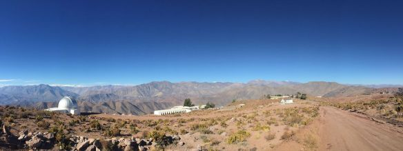 Pachón in the distance, taken from the dormitories at Cerro Tololo Inter-American Observatory (CTIO). Pachón is the flat top mountain at the right, sort of at the end of the road in front. Gemini is in the middle of that mountain, with SOAR to the left and LSST on the right edge of that ridge.